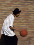 Dribbling the Basketball Photographic Print