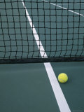 Tennis Ball Resting Near Net Photographic Print