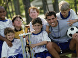 Portrait of a Soccer Team And Coach with a Trophy Photographic Print