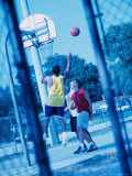 Young Men Playing Basketball Photographic Print
