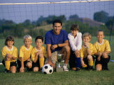 Portrait of a Soccer Team And Coach on a Field with a Trophy Photographic Print