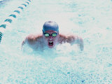 Young Man Swimming in a Swimming Pool Photographic Print