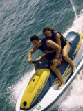 Mid Adult Couple Riding a Jet Ski in the Sea Photographic Print