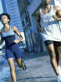 Young Couple Jogging Together Photographic Print