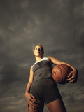 Low Angle View of a Young Woman Holding a Basketball Photographic Print