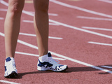 Low Section View of a Female Athlete Standing on a Running Track Photographic Print