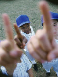 High Angle View of Three Boys from a Little League Baseball Team Photographic Print