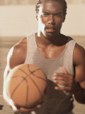 Portrait of a Basketball Player Holding a Ball Photographic Print