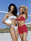 Portrait of Two Young Women Standing on the Beach with a Volleyball Photographic Print