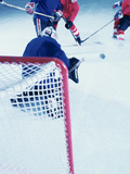 High Angle View of Ice Hockey Players Surrounding The Goal Photographic Print