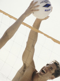 Young Men Playing Beach Volleyball Photographic Print