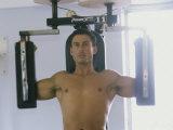 Man Using Exercise Machine Photographic Print