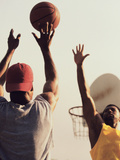 Low Angle View of Two Men Playing Basketball Papier Photo