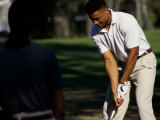 Young Man Playing Golf Photographic Print