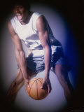 Basketball Player Holding a Basketball Photographic Print