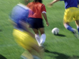 Soccer Players in Motion Photographic Print