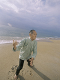 Senior Man Practicing Tai Chi on the Beach Photographic Print