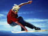 Teenage Boy Snowboarding in Mid-Air Photographic Print