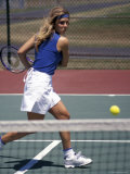 Young Woman Playing Tennis Photographic Print