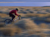 Blurred Landscape with Bicyclist Photographic Print