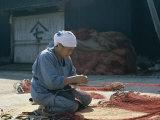 Woman Repairing Fishing Nets, Shimizu, Honshu, Japan Photographic Print