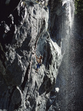 Rock Climber Near a Waterfall Photographic Print