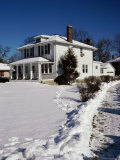 A House in a Snowcovered Landscape Photographic Print