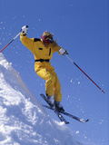Skier in Yellow Against a Blue Sky Photographic Print