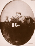 Thomas A. Edison Sitting by His Improved Machine, 1889 Photographic Print