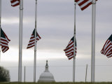 Flags at the Washington Monument Fly at Half Staff Photographic Print by Gerald Herbert
