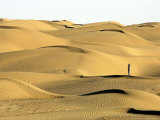 A Visitor Stands on Sand Dune in the Taklimakan Desert Photographic Print by Eugene Hoshiko