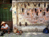 A Shoe Repair Woman Works on a Street Photographic Print