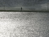 A Man Stands on the Banks of a Small Lake, Munich, on Friday, November 3, 2006. Photographic Print by Christof Stache
