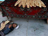 A Beggar Sleeps Next to a Bakery in Kabul, Afghanistan, Wednesday, June 7, 2006 Photographic Print by Rodrigo Abd