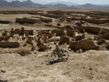 An Afghan Youth Rides His Bycicle by Houses Photographic Print by Musadeq Sadeq