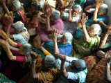 Abandoned Elderly Women Raise Hands During a Prayer Meeting Photographic Print by M. Lakshman