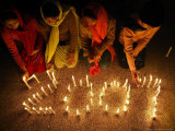 Pakistani Christian Girls Create the Digits of 2007 with Lit Candles Photographic Print by Anjum Naveed