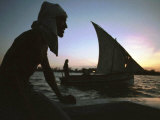 Kenyan Fisherman Leave at Sunset for a Night Spent Catching Fish Photographic Print