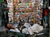 A Casual Labourer Rests, Downtown Kabul, Afghanistan, During the Afghan Weekend, June 2, 2006 Photographic Print by Rodrigo Abd