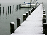 Moored Boats and a Dock are Covered by Overnight Snow at Lake Chiemsee Photographic Print
