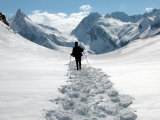 A Lone Mountain Hiker Walks in the Snow, Formazza Valley, Northern Italy Photographic Print by Fabio Polimeni