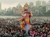 A Crowd of Revellers Carry a Statue of Ganesh Photographic Print