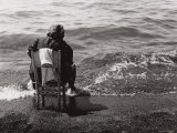 Elderly Woman Seated on the Shore-Line Photographic Print