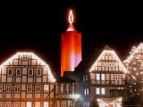 A Huge Christmas Candle Appears Above the Roofs in the Old City of Schlitz, Germany Photographic Print by Heribert Proepper
