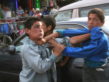 Two Afghan Children Who are Making Car Washing Work Fight Kabul, Afghanistan, June 29, 2006 Photographic Print by Rodrigo Abd