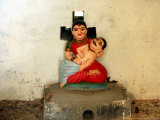 A Statue of a Woman Who Committed Sati 60 Years Ago Cradling Her Husband Photographic Print by Manish Swarup