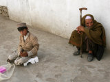 A Young Afghan Vendor Sells Toilet Paper at a Mosque Photographic Print by Rodrigo Abd