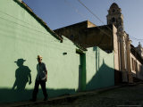 A Man Makes His Way Down Boca Street at the Historic Center of Trinidad Photographic Print by Javier Galeano