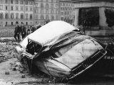 Automobile Destroyed and Flung up Against a Monument During the Flood in Florence Photographic Print