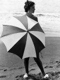 Woman with Umbrella on the Beach Photographic Print